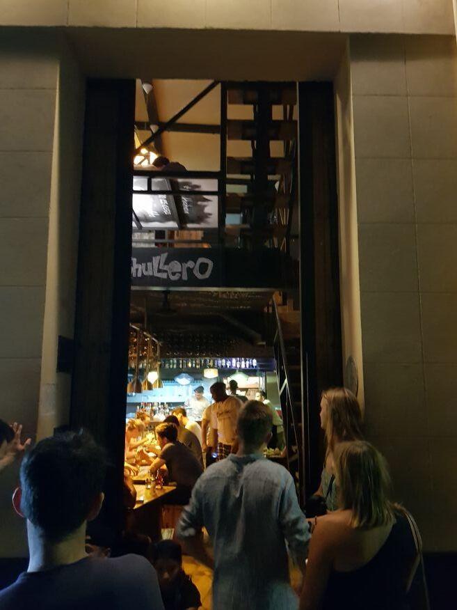 Crowd waiting outside El Chanchullero Restaurant Old Havana Cuba