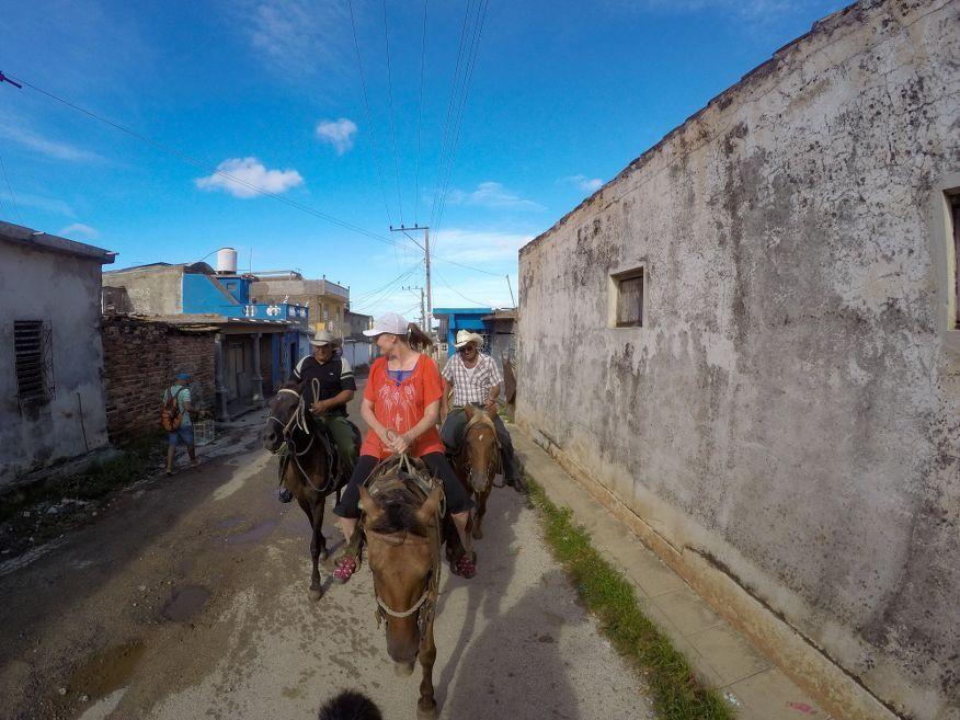 Walk through town on our Horse Ride Tour to Waterfalls Trinidad Cuba
