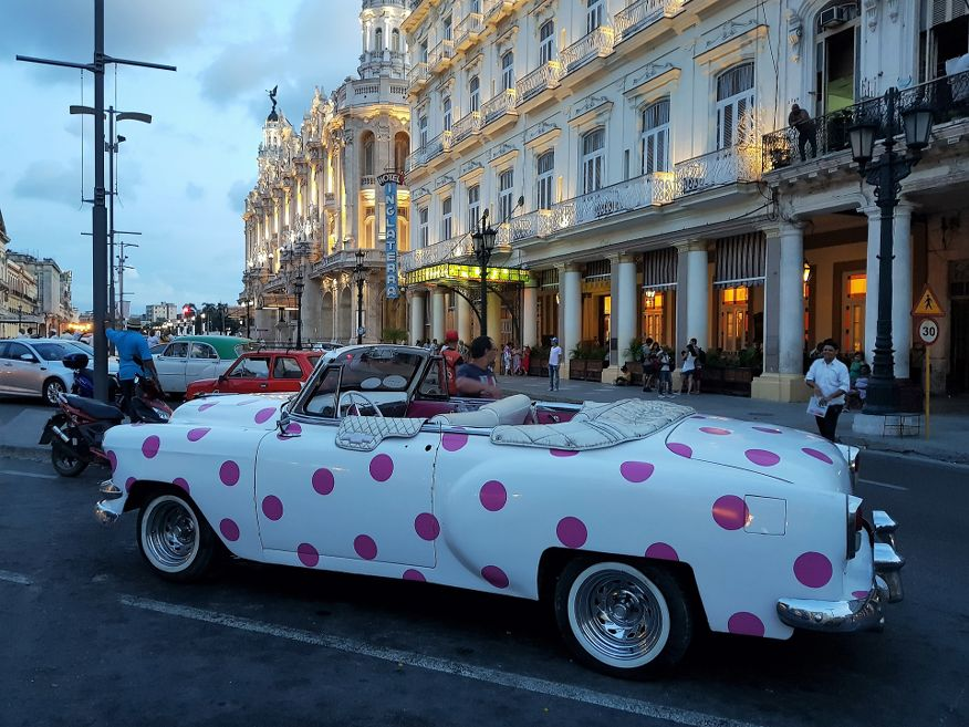 Cute pink poka dot classic American Car ready for your tour