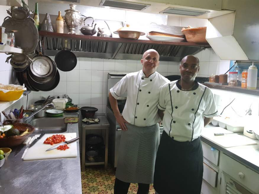 Very clean kitchen with chefs at Ivan Chef Justo Restaurant Old Havana Cuba