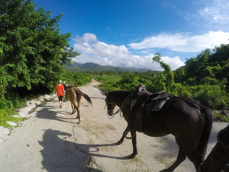Walked our horses down the hill Horse Ride Tour to Waterfalls Trinidad Cuba