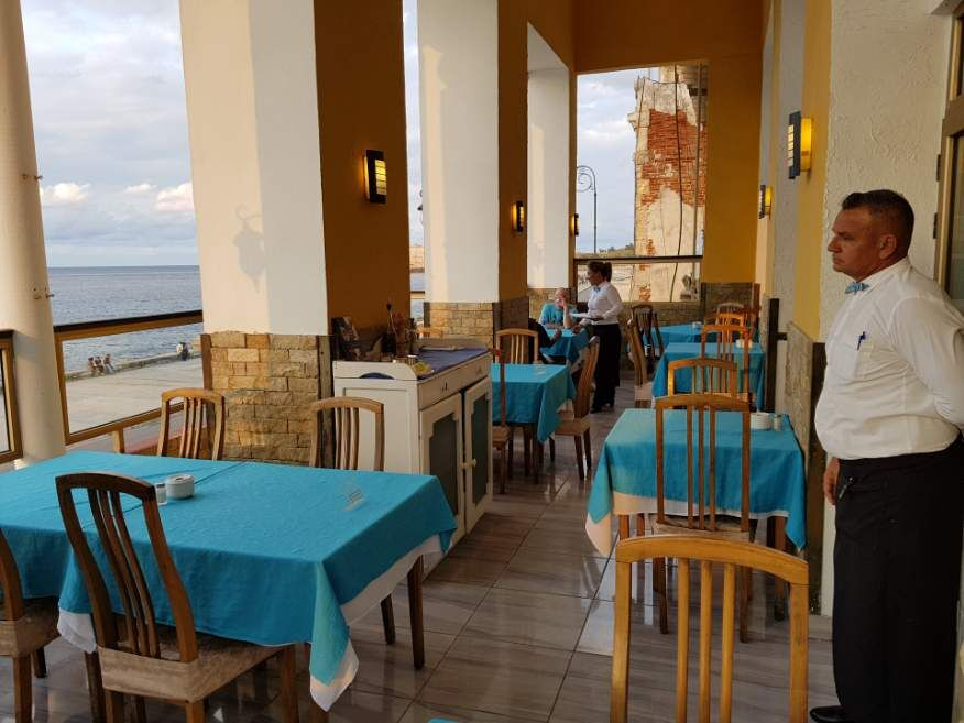 Balcony dining at Castropol Restaurant Havana Cuba