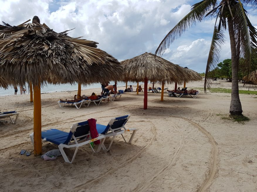 Beach chairs at Playa Ancon Beach Trinidad Cuba