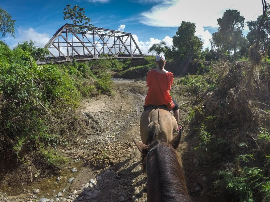 Coming up to a stream crossing Horse Ride Tour to Waterfalls Trinidad Cuba