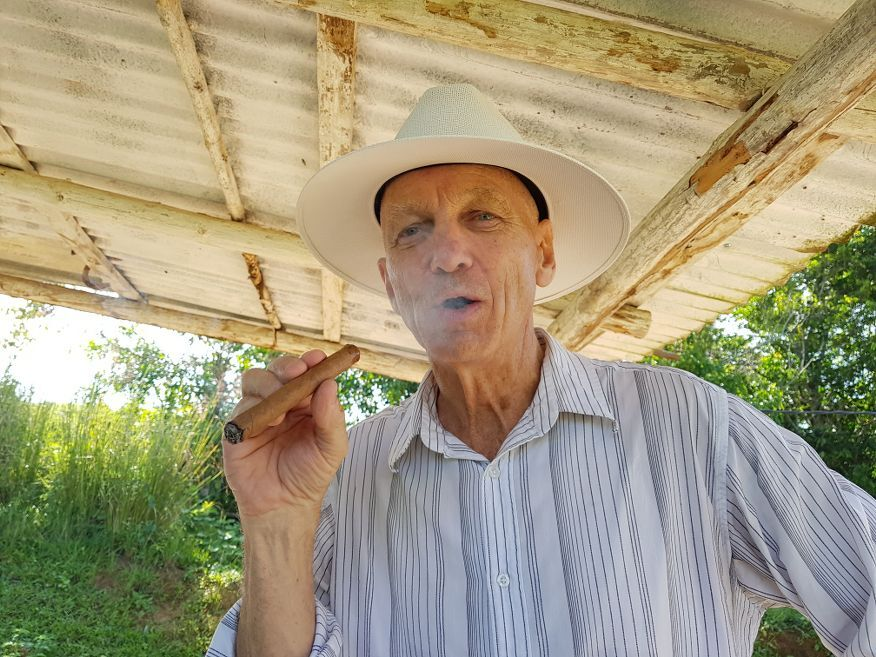Garry smoking his cigar horse ride tour from Vinales Cuba