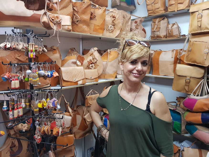 Local selling her leather wears at the handicraft markets Havana Cuba