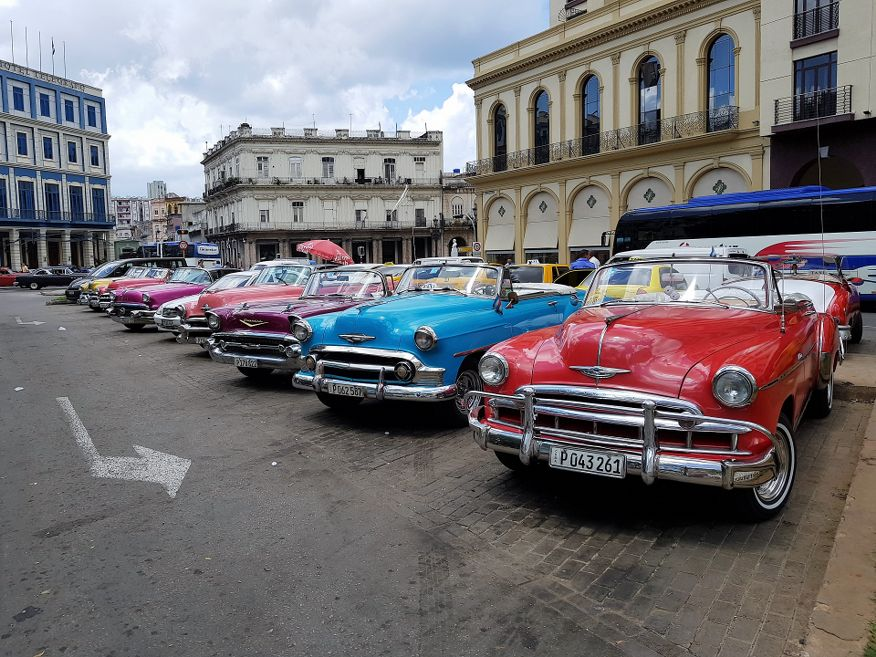 Old 50's cars waiting for tours in front of Hotel Parque central, Havana.