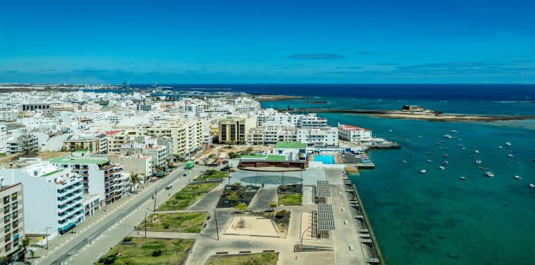 arrecife-cityscape-view-of-beachside-apartments-boardwalk-and-local-fishing-boats