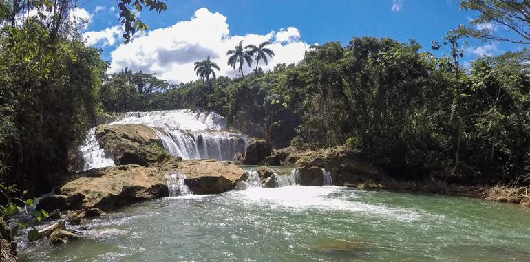 cuba-cienfuegos-attraction-el-nicho-waterfalls-on-blue-sky-day