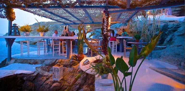 Nighttime Outdoor Patio Seating with Sea View @ Spilia Restaurant