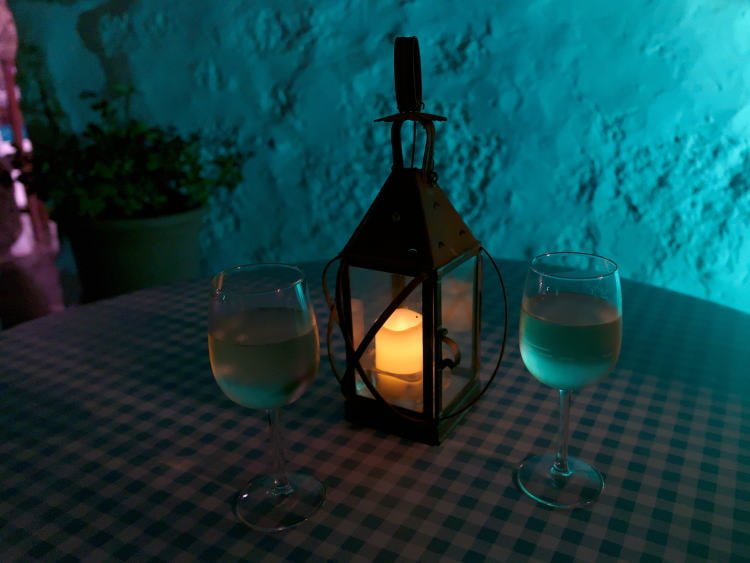 lanzarote-dining-yaiza-la-era-restaurant-two-white-wine-glasses-illuminated-by-candle-lantern