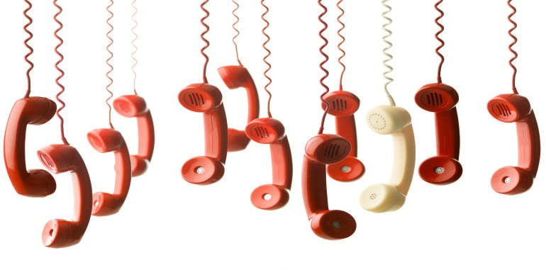 lanzarote-emergency-number-important-vintage-red-phone-handsets-hanging-on-cords-alongside-one-yellow-handset