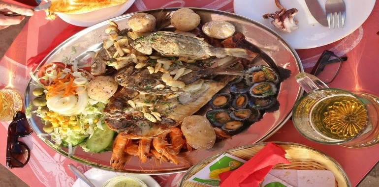 lanzarote-food-typical-rich-fish-platter-for-two-person-with-sea-bass-served-outdoors-with-shrimp-salad-potatoes