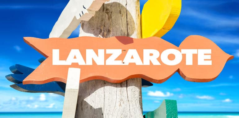 lanzarote-welcome-sign-post-with-blue-sky-beachy-background