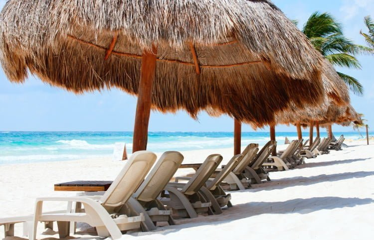 mexico-tulum-beach-ziggys-beach-club-white-sands-close-up-lounge-chairs-under-palm-shades-blue-waters