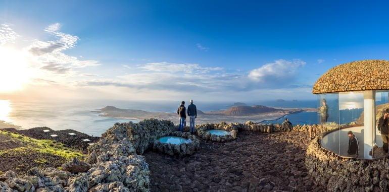 mirador-del-rio-lookout-tourists-view-atlantic-ocean-and-la-graciosa-island-at-sunset