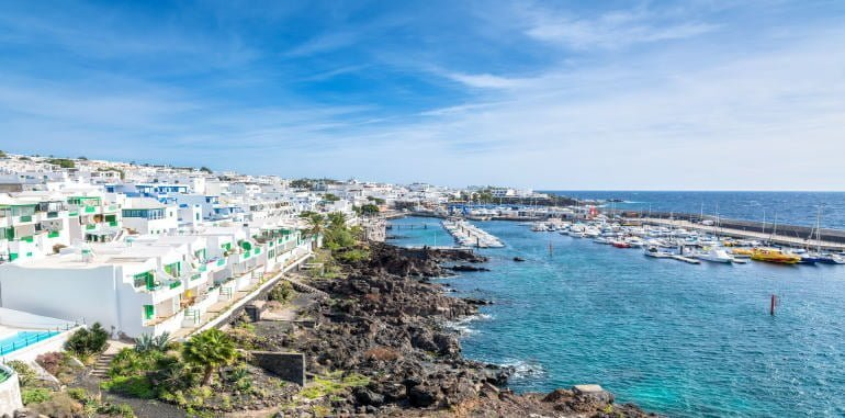 puerto-del-carmen-day-view-of-old-town-housing-marina-and-port-boardwalk