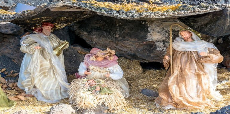 three-kings-festival-christmas-nativity-scene-in-street-showing-cave-with-baby-jesus-mary-and-joseph
