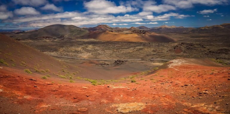 timanfaya-national-park panoramic-view-red-dirt-mountains-of-fire